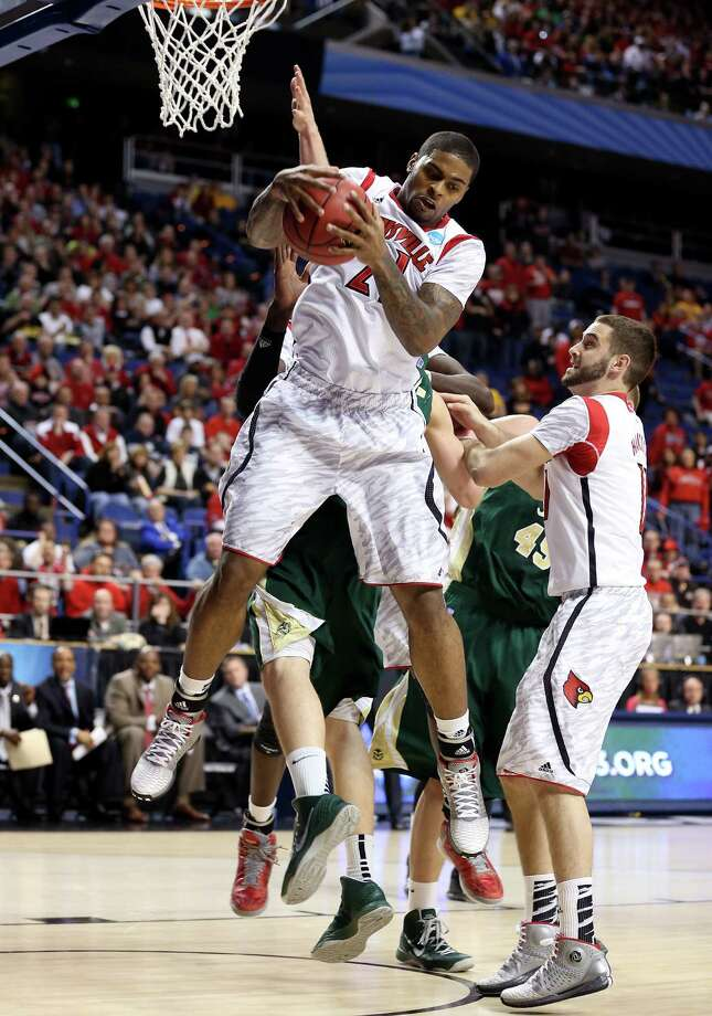 LEXINGTON, KY - MARCH 23: Chane Behanan #21 of the Louisville Cardinals pulls down a rebound against the Colorado State Rams in the first half during the third round of the 2013 NCAA Men's Basketball Tournament at Rupp Arena on March 23, 2013 in Lexington, Kentucky. Photo: Andy Lyons, Getty Images / 2013 Getty Images