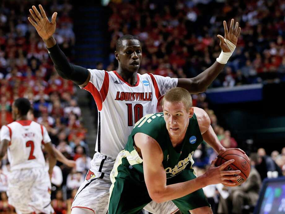 LEXINGTON, KY - MARCH 23: Colton Iverson #45 of the Colorado State Rams handles the ball against Gorgui Dieng #10 of the Louisville Cardinals in the first half during the third round of the 2013 NCAA Men's Basketball Tournament at Rupp Arena on March 23, 2013 in Lexington, Kentucky. Photo: Kevin C. Cox, Getty Images / 2013 Getty Images
