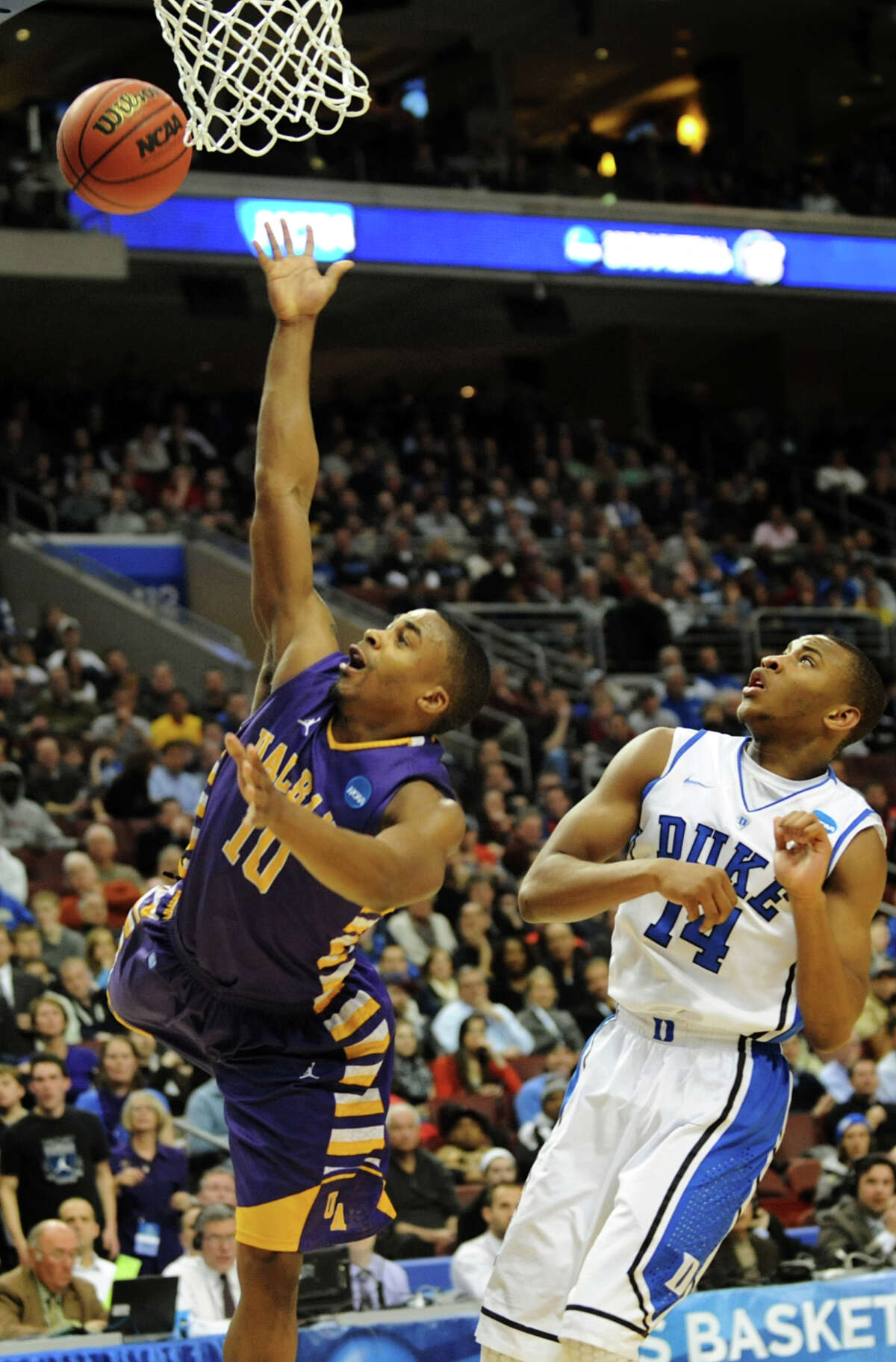 UAlbany's Mike Black, left, shoots for the hoop as Duke's Rasheed Sulaimon defends in the second round NCAA Tournament on Friday, March 22, 2013, at Wells Fargo Center in Philadelphia, Penn. (Cindy Schultz / Times Union)
