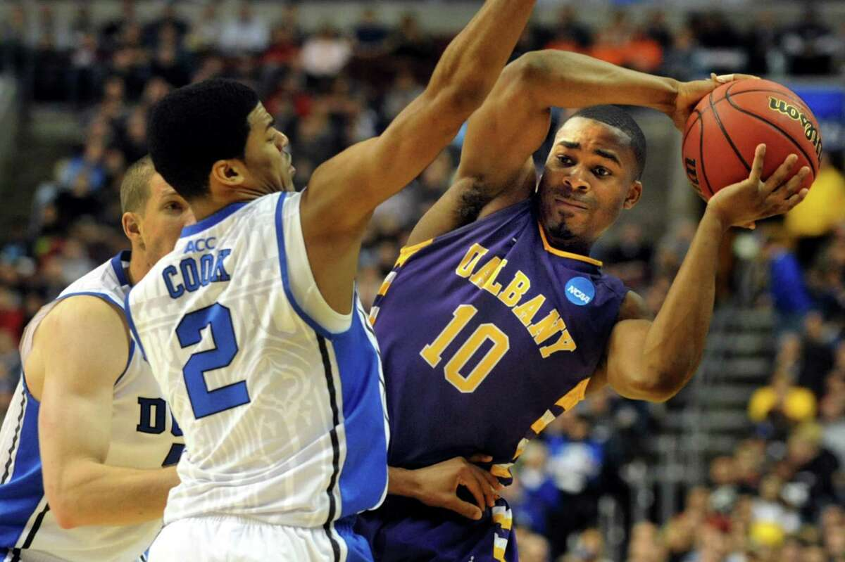 UAlbany's Mike Black, right, tries to pass around Duke's Quinn Cook during their second round NCAA Tournament on Friday, March 22, 2013, at Wells Fargo Center in Philadelphia, Penn. (Cindy Schultz / Times Union)