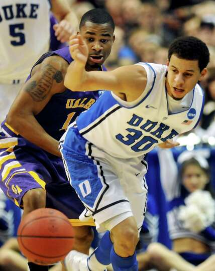 UAlbany's Mike Black, left, and Duke's Seth Curry go after a loose ball during their second round NC