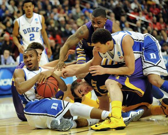 Duke comes up with the ball after a struggle with UAlbany during their second round NCAA Tournament on Friday, March 22, 2013, at Wells Fargo Center in Philadelphia, Penn. (Cindy Schultz / Times Union) Photo: Cindy Schultz