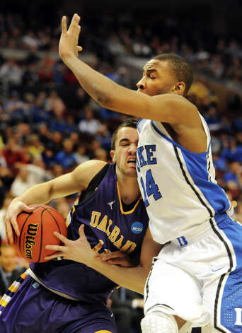 UAlbany's Peter Hooley, left, can't get past Duke's Rasheed Sulaimon during their second round NCAA Tournament on Friday, March 22, 2013, at Wells Fargo Center in Philadelphia, Penn. (Cindy Schultz / Times Union) Photo: Cindy Schultz