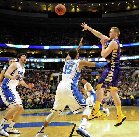 UAlbany's Luke Devlin, right, passes the ball during their second round NCAA Tournament against Duke on Friday, March 22, 2013, at Wells Fargo Center in Philadelphia, Penn. (Cindy Schultz / Times Union) Photo: Cindy Schultz