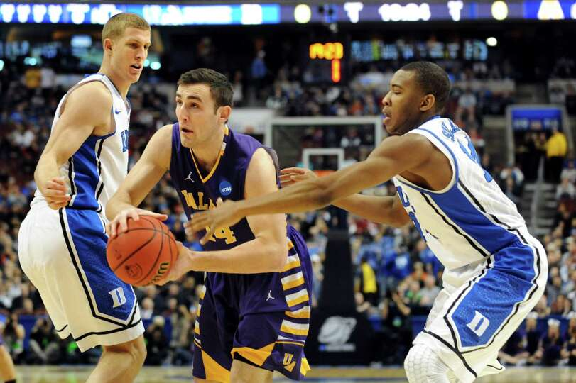 UAlbany's Sam Rowley, center, works his way to the hoop as Duke's Mason Plumlee, left, and Rasheed S