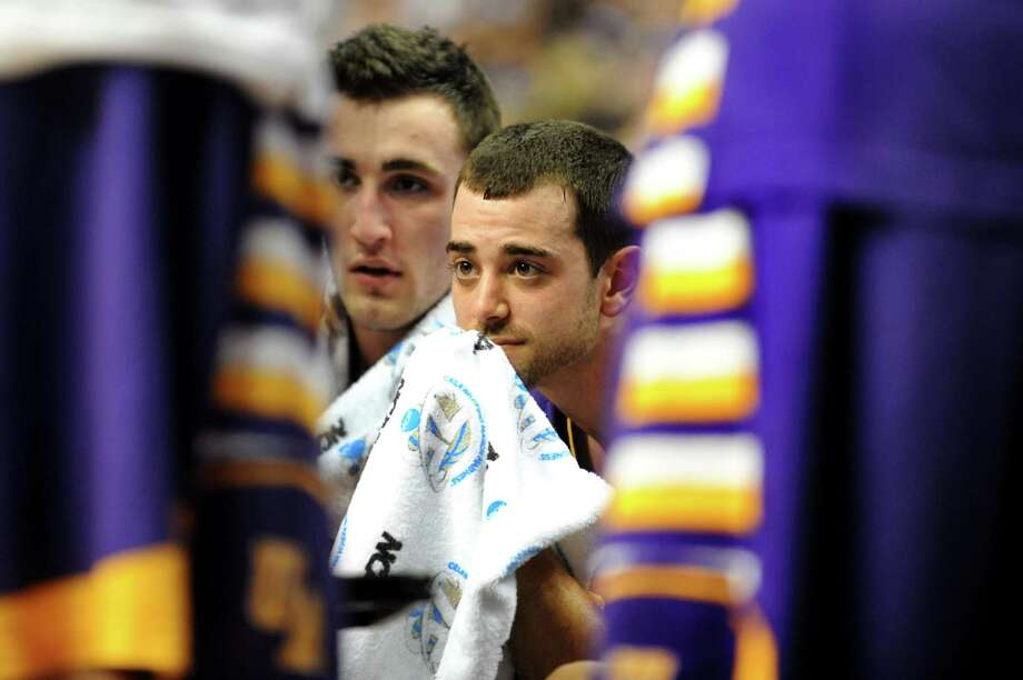 UAlbany's Sam Rowley, left, and Jacob Iati huddle with the team during their second round NCAA Tournament against Duke on Friday, March 22, 2013, at Wells Fargo Center in Philadelphia, Penn. (Cindy Schultz / Times Union) Photo: Cindy Schultz