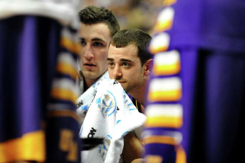 UAlbany's Sam Rowley, left, and Jacob Iati huddle with the team during their second round NCAA Tourn