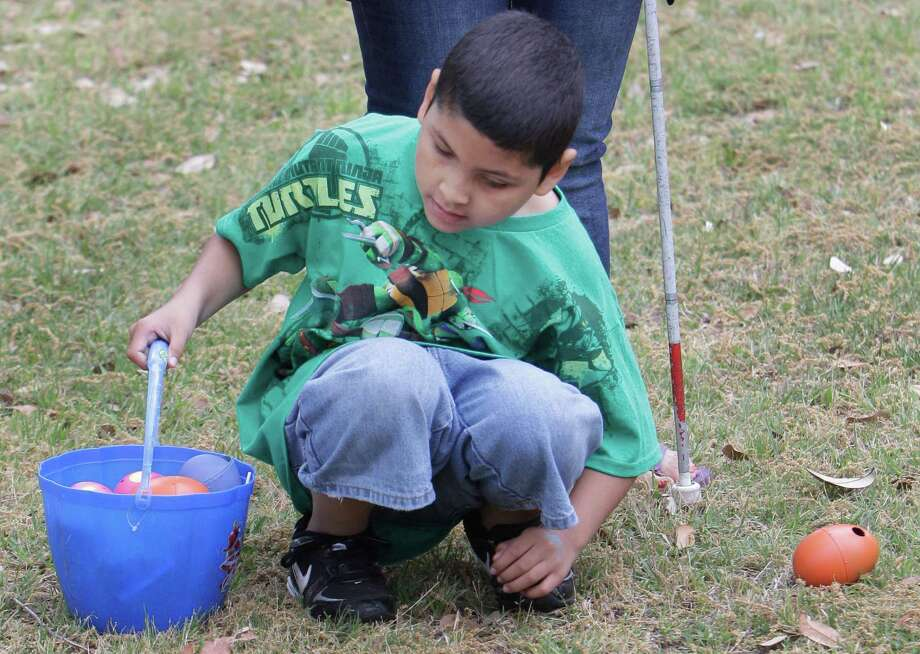Javier Lopez, 9, listens to locate a beeping egg during the Beeping Easter Egg Hunt at The Lighthouse of Houston Community Services Center. Photo: Melissa Phillip, Houston Chronicle / © 2013  Houston Chronicle