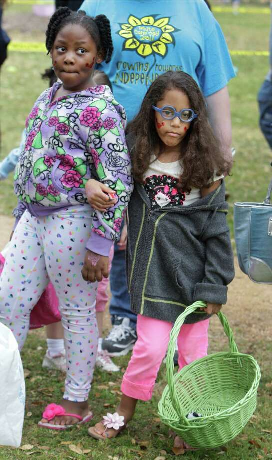 Shamia Williams, 7, left, and her friend, Farrah Lewis, 5, wait to begin the Beeping Easter Egg Hunt. Photo: Melissa Phillip, Houston Chronicle / © 2013  Houston Chronicle