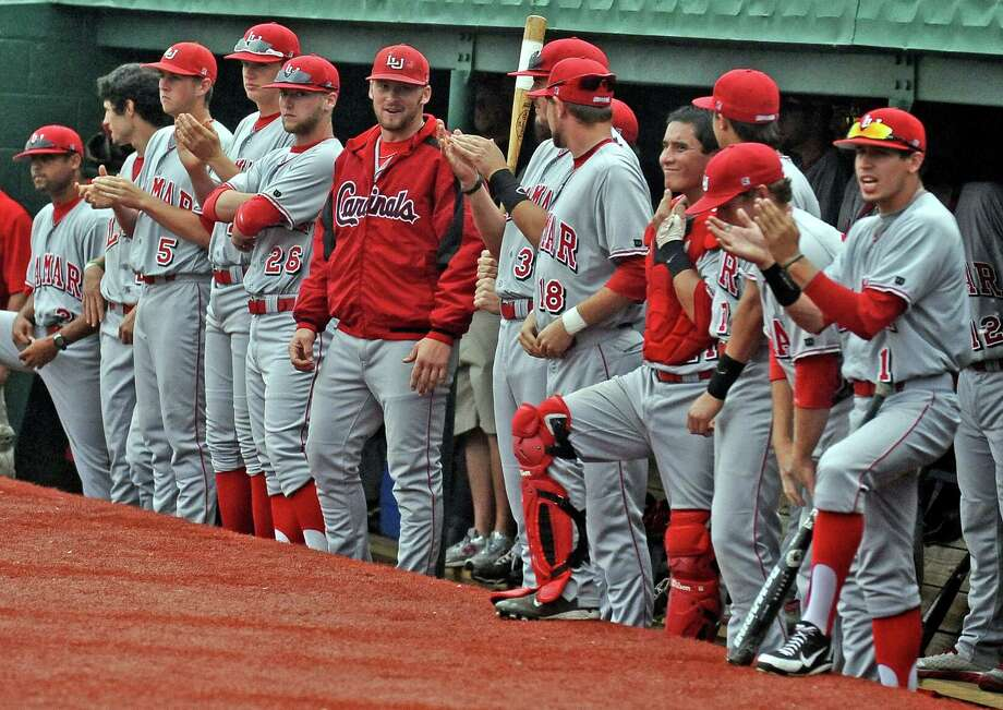 Lamar players cheer on a teammate during the Lamar University baseball game against McNeese State University on Saturday, March 23, 2013, at Vincent-Beck Stadium.   Photo taken: Randy Edwards/The Enterprise Photo: Randy Edwards