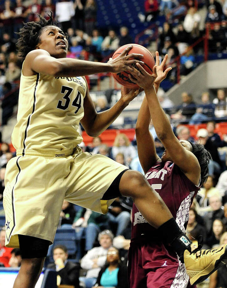 Vanderbilt's Tiffany Clarke, left, goes up for a basket while guarded by Saint Joseph's Ashley Prim, right, during the second half of a first-round game in the women's NCAA college basketball tournament in Storrs, Conn., Saturday, March 23, 2013. Vanderbilt won 60-54.  (AP Photo/Jessica Hill) Photo: Jessica Hill, Associated Press / FR125654 AP
