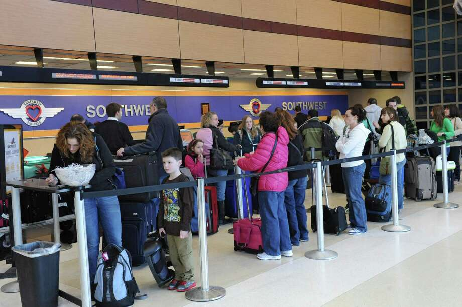 The Albany International Airport is busy with travelers because of the holiday weekend on Friday Feb. 15, 2013 in Colonie, N.Y. (Lori Van Buren / Times Union) Photo: Lori Van Buren / 00021160A