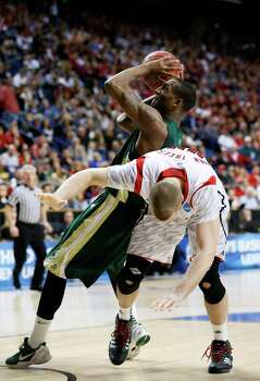 LEXINGTON, KY - MARCH 23: Greg Smith #44 of the Colorado State Rams gets fouled by Stephan Van Treese #44 of the Louisville Cardinals in the second half during the third round of the 2013 NCAA Men's Basketball Tournament at Rupp Arena on March 23, 2013 in Lexington, Kentucky. Photo: Kevin C. Cox, Getty Images / 2013 Getty Images