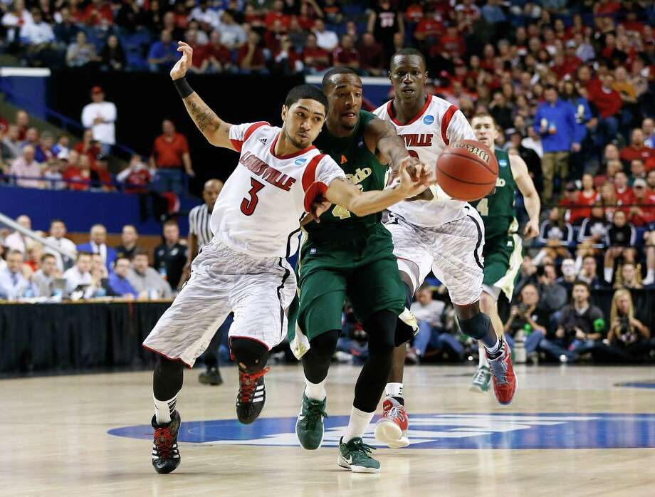 LEXINGTON, KY - MARCH 23: Peyton Siva #3 of the Louisville Cardinals steals the ball from Greg Smith #44 of the Colorado State Rams in the second half during the third round of the 2013 NCAA Men's Basketball Tournament at Rupp Arena on March 23, 2013 in Lexington, Kentucky. Photo: Kevin C. Cox, Getty Images / 2013 Getty Images