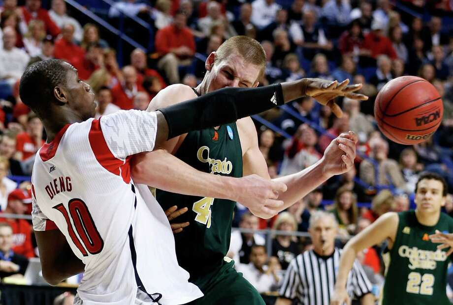 LEXINGTON, KY - MARCH 23:  Colton Iverson #45 of the Colorado State Rams handles the ball and is fouled by Gorgui Dieng #10 of the Louisville Cardinals in the second half during the third round of the 2013 NCAA Men's Basketball Tournament at Rupp Arena on March 23, 2013 in Lexington, Kentucky. Photo: Kevin C. Cox, Getty Images / 2013 Getty Images