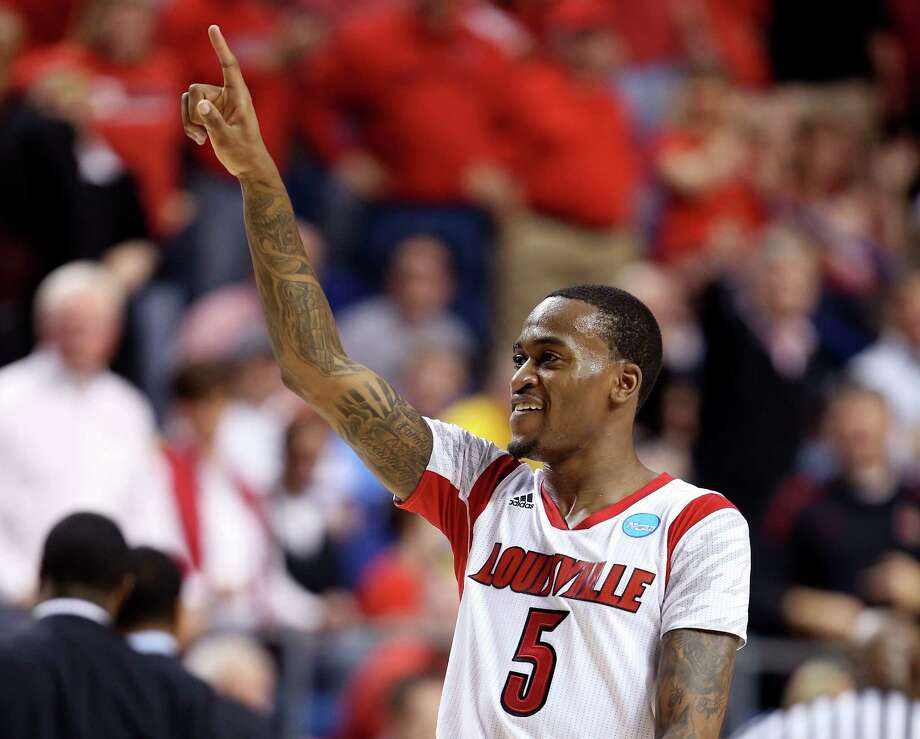 LEXINGTON, KY - MARCH 23:  Kevin Ware #5 of the Louisville Cardinals reacts after a play against the Colorado State Rams in the first half during the third round of the 2013 NCAA Men's Basketball Tournament at Rupp Arena on March 23, 2013 in Lexington, Kentucky. Photo: Andy Lyons, Getty Images / 2013 Getty Images