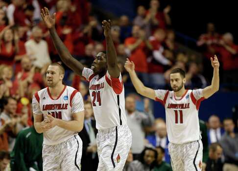 Louisville 82, Colorado State 56From left to right, Louisville's Stephan Van Treese, Montrezl Harrell and Luke Hancock react after a basket in the first half of a third-round NCAA college basketball tournament game against Colorado State, Saturday, March 23, 2013, in Lexington, Ky. (AP Photo/John Bazemore) Photo: John Bazemore, Associated Press / AP