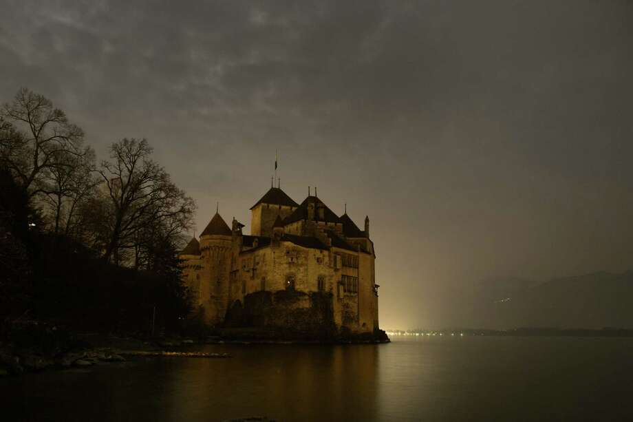 The Chillon Castle is seen with lights off on the edge of Lake Geneva near Montreux, taking part of the Earth Hour on March 23, 2013. Millions of people were expected to switch off their lights for Earth Hour in a global effort to raise awareness about climate change. Since it began in Sydney in 2007, Earth Hour has grown to become what environmental group WWF says is the world's largest demonstration of support for action on carbon pollution. Photo: FABRICE COFFRINI, AFP/Getty Images / AFP