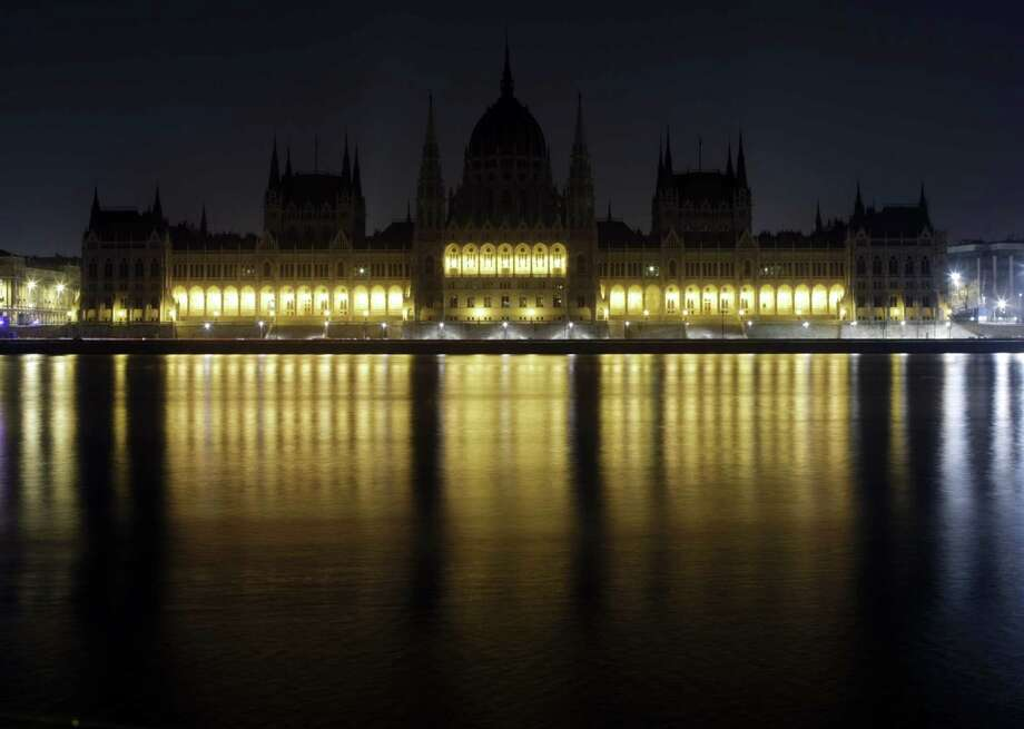 The Hungarian Parliament is pictured in downtown Budapest on March 23, 2013 the Earth hour when the lights are turned off for an hour to save energy. Millions of people were expected to switch off their lights for Earth Hour in a global effort to raise awareness about climate change. Since it began in Sydney in 2007, Earth Hour has grown to become what environmental group WWF says is the world's largest demonstration of support for action on carbon pollution. Photo: FERENC ISZA, AFP/Getty Images / AFP