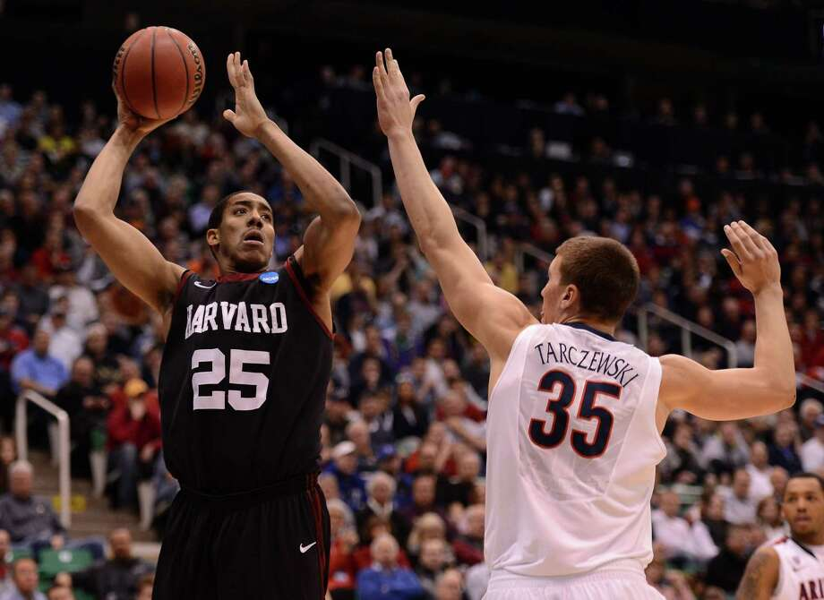 SALT LAKE CITY, UT - MARCH 23:  Kenyatta Smith #25 of the Harvard Crimson shoots over Kaleb Tarczewski #35 of the Arizona Wildcats in the second half during the third round of the 2013 NCAA Men's Basketball Tournament at EnergySolutions Arena on March 23, 2013 in Salt Lake City, Utah. Photo: Harry How, Getty Images / 2013 Getty Images