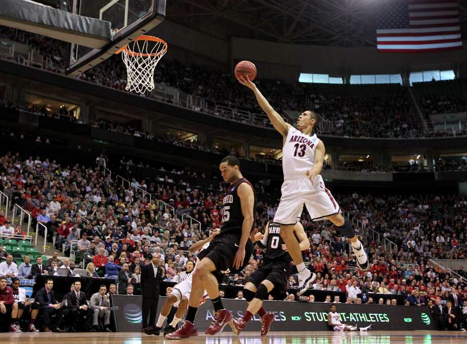 SALT LAKE CITY, UT - MARCH 23:  Nick Johnson #13 of the Arizona Wildcats goes up for a shot over Christian Webster #15 of the Harvard Crimson in the first half during the third round of the 2013 NCAA Men's Basketball Tournament at EnergySolutions Arena on March 23, 2013 in Salt Lake City, Utah. Photo: Streeter Lecka, Getty Images / 2013 Getty Images