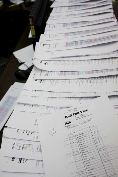The roll call voting records for amendments to the Senate budget sit on a table at the Senate Press Gallery. Photo: Christopher Gregory / New York Times