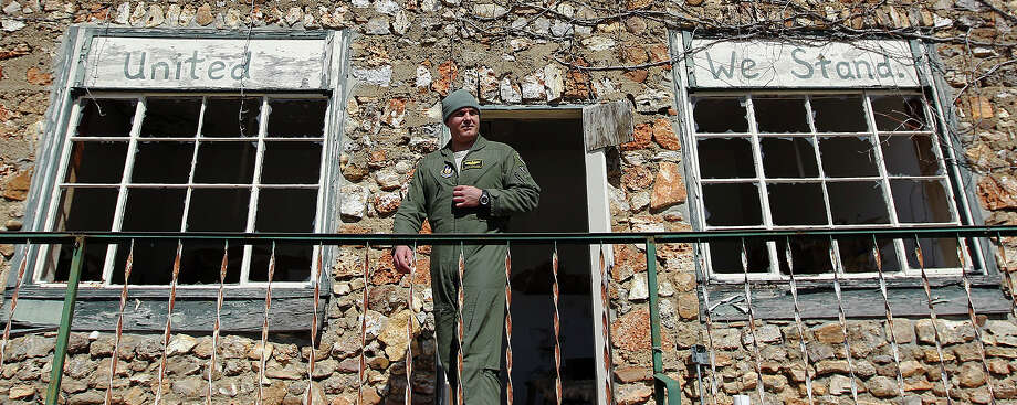 Air Force Reserve Maj. Shad Magann walks from an abandoned building  in Climax Springs, Mo. During the Iraq invasion, he was in charge of two close air support teams. Photo: Kin Man Hui, San Antonio Express-News / © 2012 San Antonio Express-News