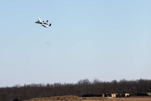 An A-10 Warthog jet makes a low pass over a target site at the Cannon Range at Fort Leonard Wood. These aircraft were used extensively during the Iraq invasion. Photo: Kin Man Hui, San Antonio Express-News / © 2012 San Antonio Express-News