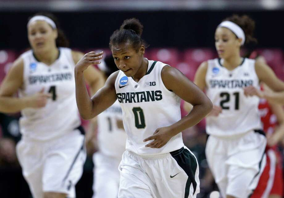 Michigan State guard Kiana Johnson, center, gestures after making a 3-pointer during the second half of a first-round game against Marist in the women's NCAA college basketball tournament in College Park, Md., Saturday, March 23, 2013. Johnson contributed a game-high 16 points to Michigan State's 55-47 win. Photo: Patrick Semansky