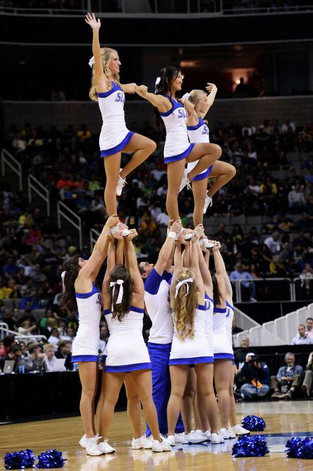 SAN JOSE, CA - MARCH 23:  Saint Louis Billikens cheerleaders perform in the first half against the Oregon Ducks during the third round of the 2013 NCAA Men's Basketball Tournament at HP Pavilion on March 23, 2013 in San Jose, California. Photo: Thearon Henderson, Getty Images / 2013 Getty Images