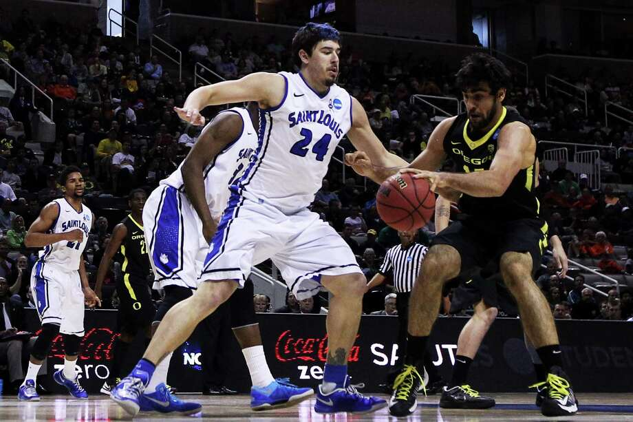SAN JOSE, CA - MARCH 23:  Cody Ellis #24 of the Saint Louis Billikens and Arsalan Kazemi #14 of the Oregon Ducks vie for posession in the first half during the third round of the 2013 NCAA Men's Basketball Tournament at HP Pavilion on March 23, 2013 in San Jose, California. Photo: Ezra Shaw, Getty Images / 2013 Getty Images
