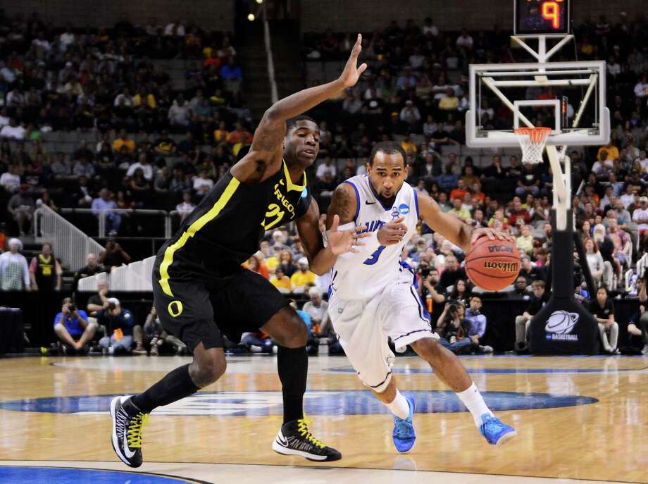 Oregon 74, Saint Louis 57SAN JOSE, CA - MARCH 23:  Kwamain Mitchell #3 of the Saint Louis Billikens drives against Damyean Dotson #21 of the Oregon Ducks in the first half during the third round of the 2013 NCAA Men's Basketball Tournament at HP Pavilion on March 23, 2013 in San Jose, California. Photo: Thearon Henderson, Getty Images / 2013 Getty Images