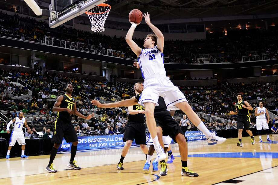 SAN JOSE, CA - MARCH 23:  Rob Loe #51 of the Saint Louis Billikens goes up against the Oregon Ducks in the first half during the third round of the 2013 NCAA Men's Basketball Tournament at HP Pavilion on March 23, 2013 in San Jose, California. Photo: Thearon Henderson, Getty Images / 2013 Getty Images