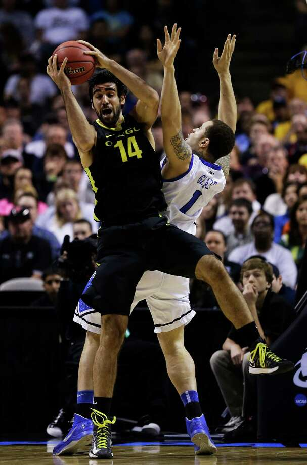 SAN JOSE, CA - MARCH 23:  Arsalan Kazemi #14 of the Oregon Ducks rebounds over Grandy Glaze #1 of the Saint Louis Billikens in the first half during the third round of the 2013 NCAA Men's Basketball Tournament at HP Pavilion on March 23, 2013 in San Jose, California. Photo: Ezra Shaw, Getty Images / 2013 Getty Images