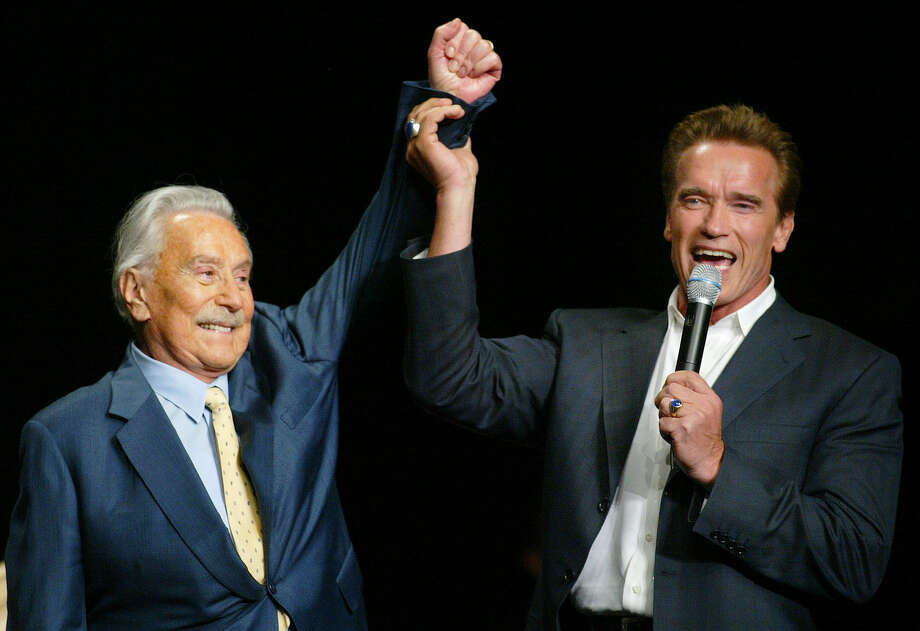 Bodybuilding expert Joe Weider is shown with Arnold Schwarzenegger, whom he brought to the United States and mentored as a bodybuilder. Photo: Associated Press File Photo