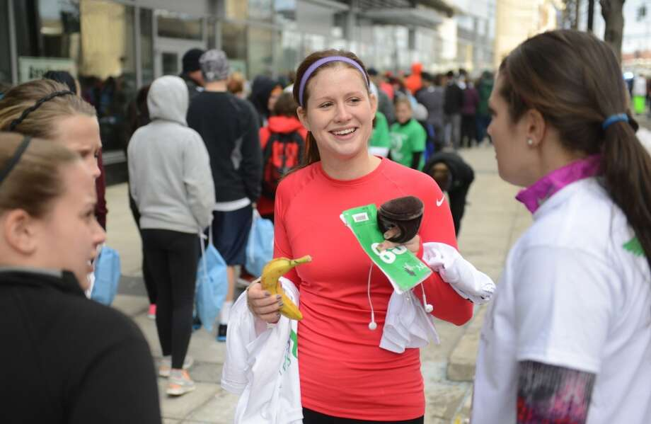 Megan Sheffield, a teacher from Greenwich, hangs out with friends before participating in the Sandy Hook Run for the Families 5K in Hartford, Conn. on Saturday, March 23, 2013.  About 15,000 people participated in the event and proceeds went to the Sandy Hook School Support Fund.
