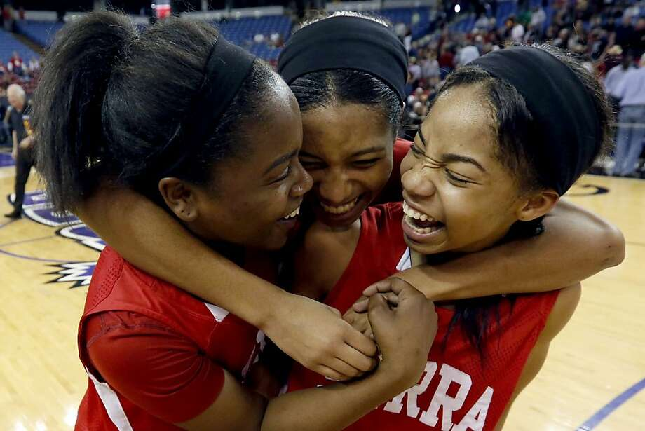 In this 2013 file photo, From left, Serra's Siera Thompson, Caila Hailey and Deandrea Toler celebrate their 62-60 win over Salesian in the CIF girls Division IV state high school basketball championship game in Sacramento, Calif., Saturday, March 23, 2013. (AP Photo/Rich Pedroncelli) Photo: Rich Pedroncelli, Associated Press