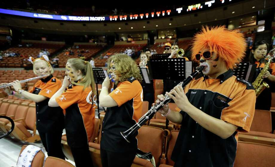 Pacific band members play to a scant crowd during a second-round game against Miami on Friday in Austin. San Antonio will host second- and third-round contests next year.  David J. Phillip/Associated Press Photo: David J. Phillip, Associated Press / AP