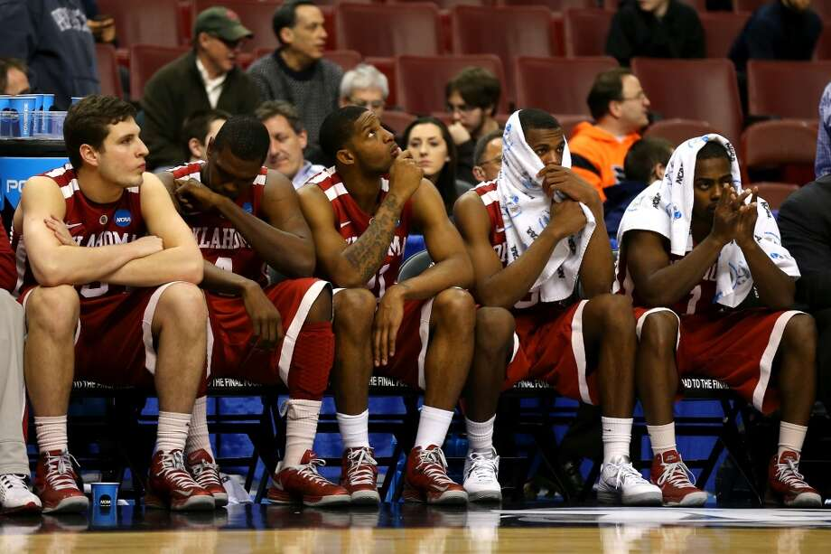 PHILADELPHIA, PA - MARCH 22:  (L-R) Tyler Neal #15, Andrew Fitzgerald #4, Cameron Clark #21, Buddy Hield #3 and Sam Grooms #1 of the Oklahoma Sooners sit on the bench dejected in the closing seconds against the San Diego State Aztecs during the second round of the 2013 NCAA Men's Basketball Tournament at Wells Fargo Center on March 22, 2013 in Philadelphia, Pennsylvania.  (Photo by Elsa/Getty Images)