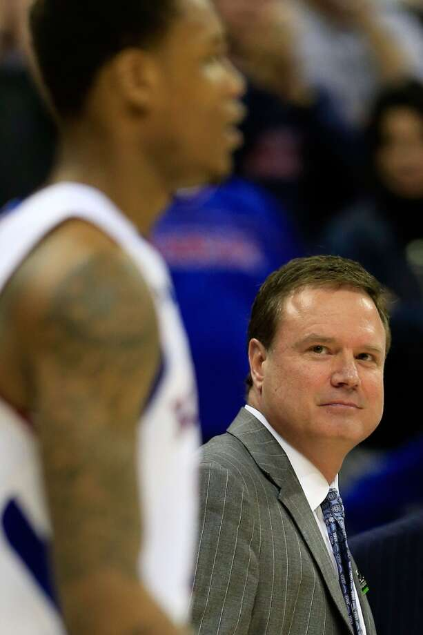 KANSAS CITY, MO - MARCH 22:  Head coach Bill Self of the Kansas Jayhawks smiles at Ben McLemore #23  in the second half against the Western Kentucky Hilltoppers during the second round of the 2013 NCAA Men's Basketball Tournament at the Sprint Center on March 22, 2013 in Kansas City, Missouri.  (Photo by Jamie Squire/Getty Images)