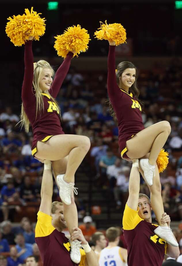AUSTIN, TX - MARCH 22:  The Minnesota Golden Gophers cheerleaders perform during the game against the UCLA Bruins during the second round of the 2013 NCAA Men's Basketball Tournament at The Frank Erwin Center on March 22, 2013 in Austin, Texas.  (Photo by Stephen Dunn/Getty Images)