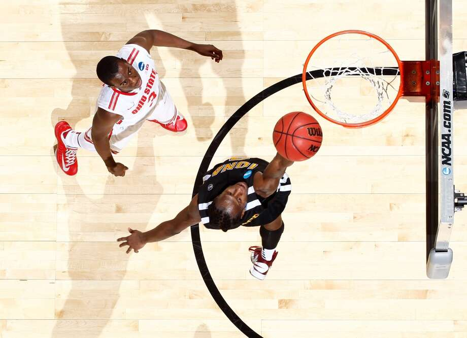 DAYTON, OH - MARCH 22: Tavon Sledge #3 of the Iona Gaels drives to the basket against Shannon Scott #3 of the Ohio State Buckeyes during the second round of the 2013 NCAA Men's Basketball Tournament at UD Arena on March 22, 2013 in Dayton, Ohio.  (Photo by Joe Robbins/Getty Images)