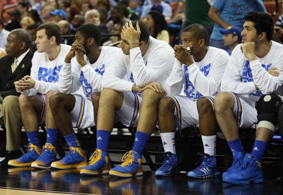 AUSTIN, TX - MARCH 22:  The UCLA Bruins bench watch the end of the game in their losing effort against the Minnesota Golden Gophers during the second round of the 2013 NCAA Men's Basketball Tournament at The Frank Erwin Center on March 22, 2013 in Austin, Texas.  (Photo by Ronald Martinez/Getty Images)