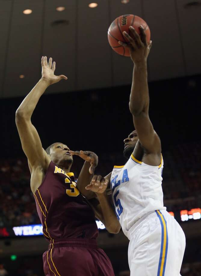 AUSTIN, TX - MARCH 22:  Shabazz Muhammad #15 of the UCLA Bruins controls the ball against Rodney Williams #33 of the Minnesota Golden Gophers during the second round of the 2013 NCAA Men's Basketball Tournament at The Frank Erwin Center on March 22, 2013 in Austin, Texas.  (Photo by Ronald Martinez/Getty Images)