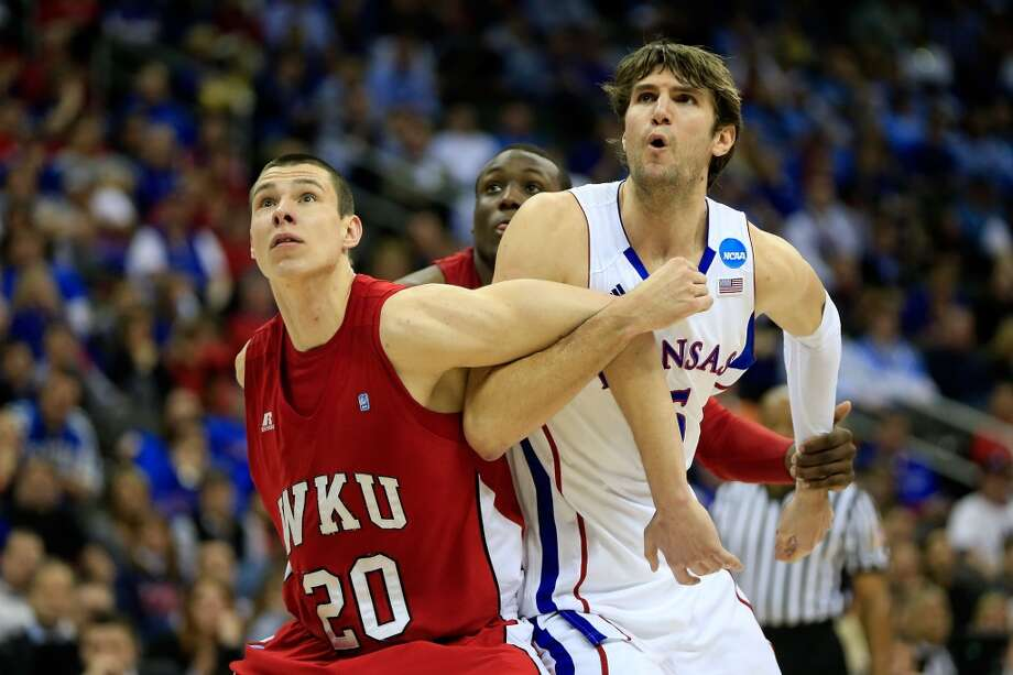 KANSAS CITY, MO - MARCH 22:  Aleksejs Rostov #20 of the Western Kentucky Hilltoppers boxes out against Jeff Withey #5 of the Kansas Jayhawks in the second half during the second round of the 2013 NCAA Men's Basketball Tournament at the Sprint Center on March 22, 2013 in Kansas City, Missouri. Kansas won 64-57.  (Photo by Jamie Squire/Getty Images)