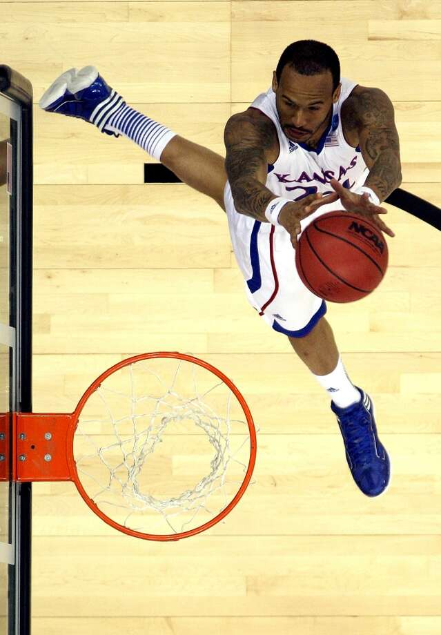 KANSAS CITY, MO - MARCH 22:  Travis Releford #24 of the Kansas Jayhawks shoots during the second round of the NCAA Basketball Tournament against the Western Kentucky Hilltoppers at the Sprint Center on March 22, 2013 in Kansas City, Missouri.  (Photo by Jamie Squire/Getty Images)