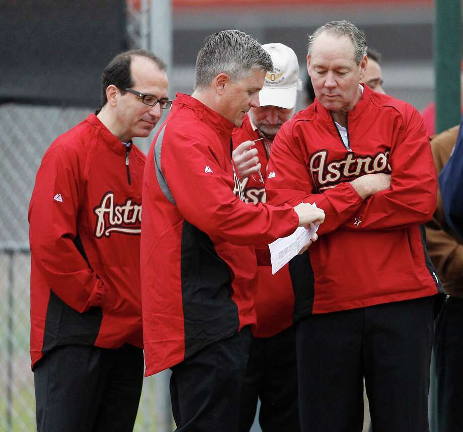 Astros owner Jim Crane, right, conferring with GM Jeff Luhnow, said he has a plan to fix the club's shortcomings, but it will take time and better cash flow. Photo: Karen Warren, Staff / © 2012  Houston Chronicle
