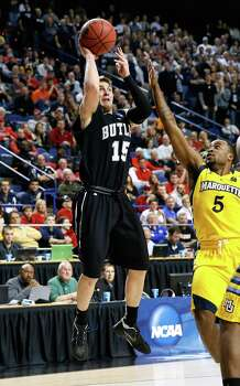 LEXINGTON, KY - MARCH 23: Rotnei Clarke #15 of the Butler Bulldogs shoots against Junior Cadougan #5 of the Marquette Golden Eagles in the first half during the third round of the 2013 NCAA Men's Basketball Tournament at Rupp Arena on March 23, 2013 in Lexington, Kentucky. Photo: Kevin C. Cox, Getty Images / 2013 Getty Images