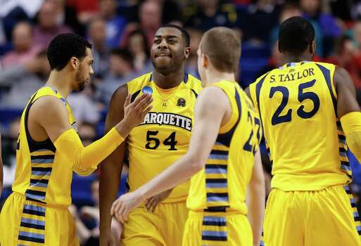 LEXINGTON, KY - MARCH 23: Davante Gardner #54 of the Marquette Golden Eagles reacts with teammates Trent Lockett #22, Jake Thomas #23 and Steve Taylor, Jr. #25 against the Butler Bulldogs in the second half during the third round of the 2013 NCAA Men's Basketball Tournament at Rupp Arena on March 23, 2013 in Lexington, Kentucky. Photo: Kevin C. Cox, Getty Images / 2013 Getty Images