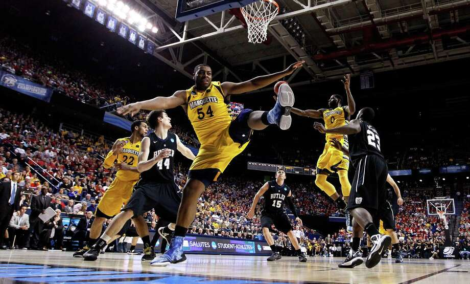 LEXINGTON, KY - MARCH 23: Davante Gardner #54 of the Marquette Golden Eagles goes for a rebound against the Butler Bulldogs in the first half during the third round of the 2013 NCAA Men's Basketball Tournament at Rupp Arena on March 23, 2013 in Lexington, Kentucky. Photo: Kevin C. Cox, Getty Images / 2013 Getty Images